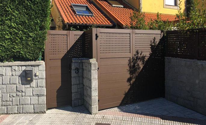Aluminios Tecnoal - Cerramiento exterior en vivienda con acabado marrón